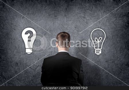 Business person choose future direction stock photo, Businessman is standing in front of two direction signs. by Sergey Nivens