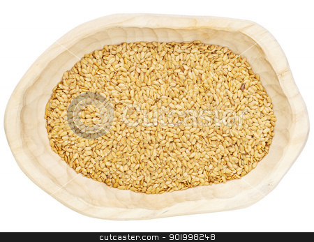 golden flax seeds stock photo, golden  flax seeds in a rustic wood bowl isolated on white, clipping path by Marek Uliasz