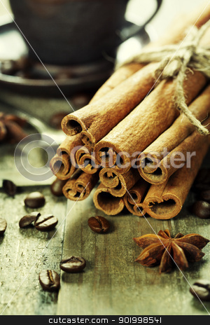 cinnamon and coffee stock photo, cinnamon, coffee and spices on wooden table by klenova