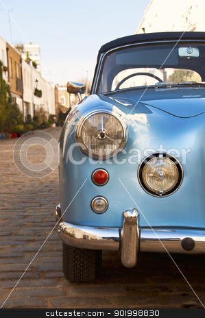 Vintage car stock photo, Blue vintage car parked in a paved street by Dutourdumonde