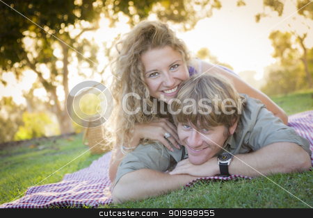Attractive Loving Couple Portrait in the Park stock photo, Happy Attractive Loving Couple Portrait in the Park. by Andy Dean