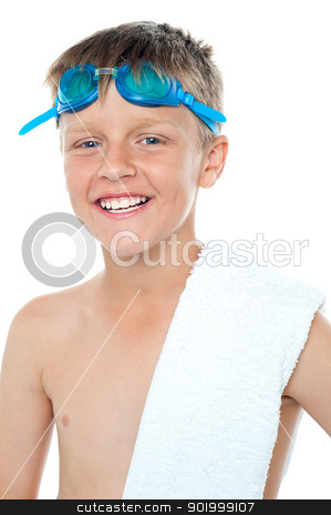 Closeup of champion swimmer boy stock photo, Closeup of champion swimmer boy wearing goggles on head along with towel on his shoulder by Ishay Botbol