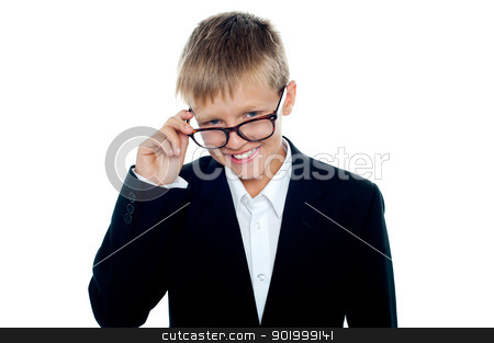 Young business boy looking through his glasses stock photo, Young business boy looking through his glasses. Taking a closer look by Ishay Botbol