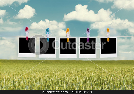Photos hanging and flying in the wind stock photo, Photos hanging and flying in the wind by ARNIS LAZDINS