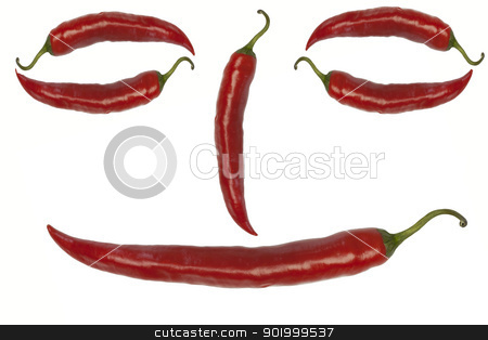 Smiley from red chili peppers on a white background  stock photo, Smiley from red chili peppers on a white background  by ARNIS LAZDINS