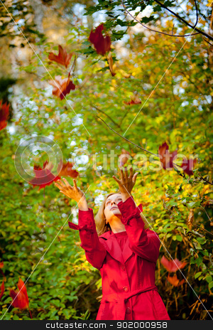 Happy fall woman stock photo, Happy fall woman playing with autumn leaves in forest by Oleg
