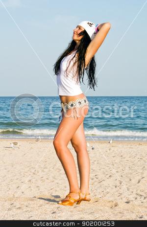 The young woman on sand at sea coast stock photo, The young woman on sand at sea coast by Sergii Sukhorukov