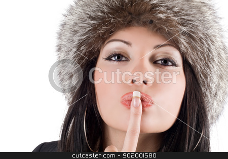 Portrait of the young woman with a finger at lips stock photo, Portrait of the young woman with a finger at lips by Sergii Sukhorukov