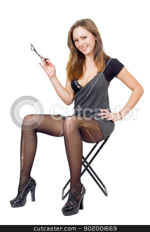 Girl with scissors in the torn stockings sits on a chair stock photo, Girl with scissors in the torn stockings sits on a chair by Sergii Sukhorukov