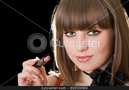 Portrait of the girl with lipstick in a hand stock photo, Portrait of the girl with lipstick in a hand by Sergii Sukhorukov