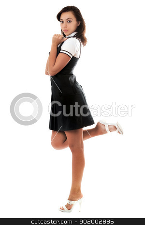 Young playful woman stock photo, Young playful woman wearing short black dress. Isolated by Sergii Sukhorukov