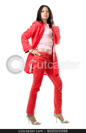 Beautiful young brunette in red suit. Isolated stock photo, Beautiful young brunette in red suit. Isolated on white by Sergii Sukhorukov