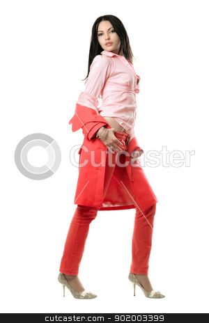 Playful young brunette in red suit. Isolated stock photo, Playful young brunette in red suit. Isolated on white by Sergii Sukhorukov