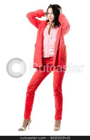 Smiling playful young brunette in red suit stock photo, Smiling playful young brunette in red suit. Isolated on white by Sergii Sukhorukov