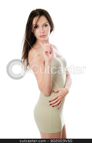 Sexy woman in tight-fitting dress stock photo, Sexy young woman in tight-fitting olive dress. Isolated by Sergii Sukhorukov