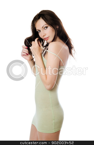 Playful brunette in olive dress stock photo, Young playful brunette in olive dress. Isolated on white by Sergii Sukhorukov