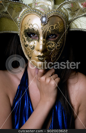 Portrait of young woman in a Venetian mask stock photo, Portrait of young woman in a Venetian mask. Isolated by Sergii Sukhorukov