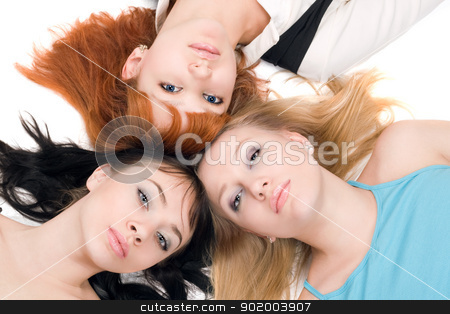 Three young women stock photo, Portrait of three young women lying on white background by Sergii Sukhorukov