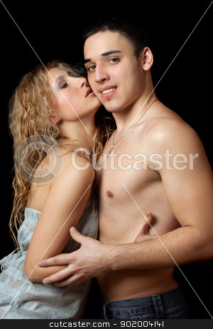 Portrait of a passionate beautiful young couple stock photo, Portrait of a passionate beautiful young couple. Isolated on black by Sergii Sukhorukov
