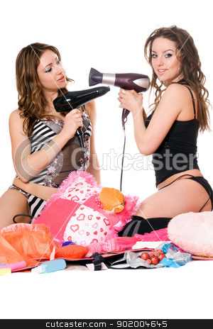 Two young girlfriends with hair dryers stock photo, Two young girlfriends with hair dryers. Isolated by Sergii Sukhorukov