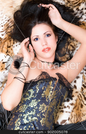 Beautiful brunette in a corset stock photo, Beautiful brunette in a corset posing on fur by Sergii Sukhorukov