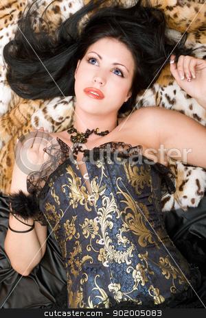 Portrait of a dreamy brunette in a corset stock photo, Portrait of a dreamy brunette in a corset posing on fur by Sergii Sukhorukov