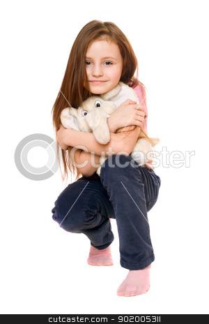 Beautiful little girl with a teddy elephant stock photo, Beautiful little girl with a teddy elephant. Isolated by Sergii Sukhorukov