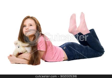 Little girl with a teddy elephant stock photo, Little girl with a teddy elephant. Isolated by Sergii Sukhorukov