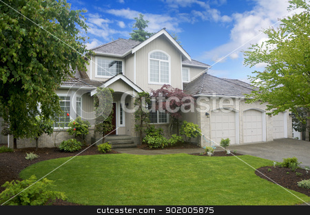 Large classic American house with three car garage. stock photo, Large classic American house with three car garage. by iriana88w
