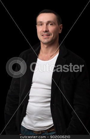 Portrait of a smiling man. Isolated stock photo, Portrait of a smiling man. Isolated on black by Sergii Sukhorukov