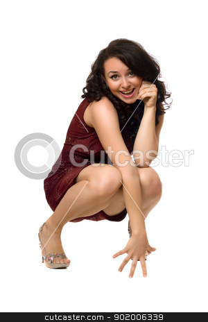 Smiling young brunette in red dress stock photo, Smiling young brunette in red dress. Isolated by Sergii Sukhorukov