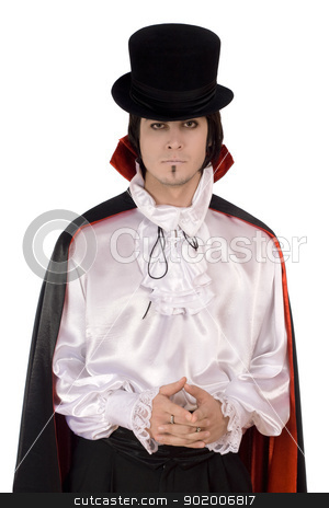 Young man in a suit of Count Dracula stock photo, Young man in a suit of Count Dracula. Isolated by Sergii Sukhorukov
