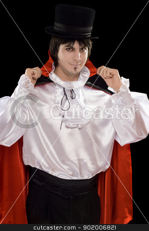 young man in a suit of Count Dracula stock photo, Portrait of young man in a suit of Count Dracula. Isolated by Sergii Sukhorukov