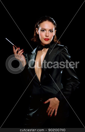 Beautiful young woman with cigarette stock photo, Beautiful young woman with cigarette wearing a black suit by Sergii Sukhorukov