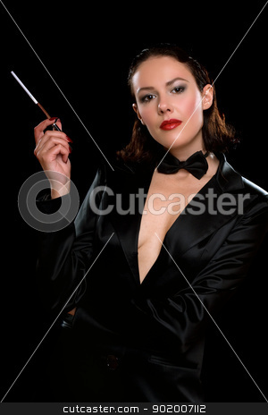 Nice young woman with cigarette stock photo, Nice young woman with cigarette wearing a black suit by Sergii Sukhorukov