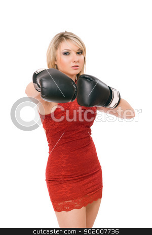 Pretty young blonde in boxing gloves stock photo, Pretty young blond woman in boxing gloves by Sergii Sukhorukov
