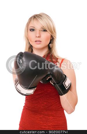 Beautiful blond girl in  boxing gloves stock photo, Beautiful young blond girl in boxing gloves by Sergii Sukhorukov
