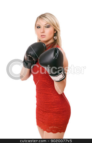 Nice blond woman in boxing gloves stock photo, Nice blond young woman in boxing gloves by Sergii Sukhorukov