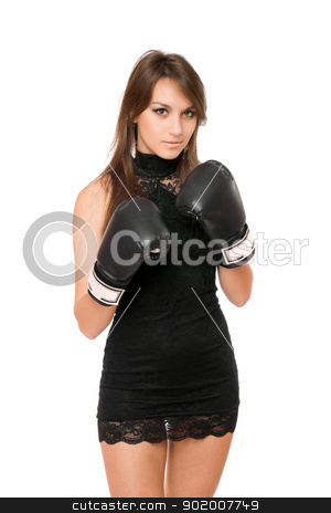 Pretty brunette woman in boxing gloves stock photo, Pretty brunette young woman in boxing gloves by Sergii Sukhorukov