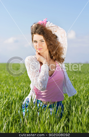 Portrait of young woman stock photo, Portrait of young woman in a green field by Sergii Sukhorukov
