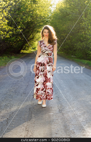 Pretty young woman stock photo, Pretty young woman standing on the road by Sergii Sukhorukov