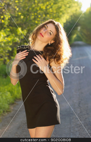 Portrait of a nice young woman stock photo, Portrait of a nice young woman in black dress by Sergii Sukhorukov