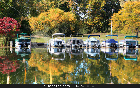 Small bots in the dock stock photo, Small bots in the dock with autumn reflection by Sreedhar Yedlapati