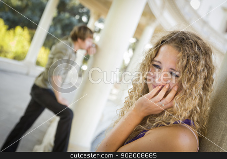 Woman Upset While Man Comtemplates in the Background stock photo, Woman Upset in the Foreground While Man Comtemplates in the Background by Andy Dean