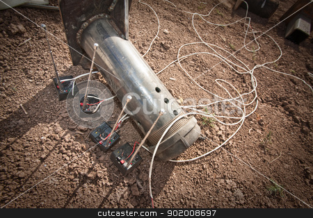 Steel Pipe Explosive Device stock photo, Steel pipe explosive with four controllers outdoors by Scott Griessel