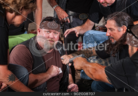 Biker Gang Member Caught Cheating stock photo, Sneaky gang member caught cheating with playing card in pocket by Scott Griessel