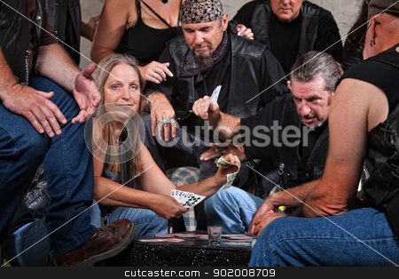 Biker Gang Member Loses to Woman stock photo, Happy white female winning card game with biker gang by Scott Griessel