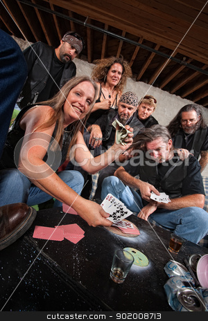 Biker Gang Card Game Winner stock photo, Winning woman and losing man playing cards by Scott Griessel