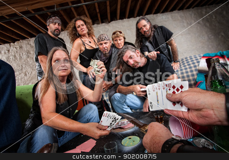 Biker Gang Lady Shows Her Cards stock photo, Pretty middle aged biker gang member shows cards to aggressive player by Scott Griessel