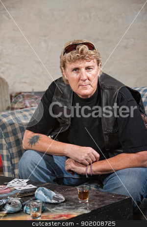 Tough Female Gang Member stock photo, Tough female gang member in black leather jacket and alcohol by Scott Griessel